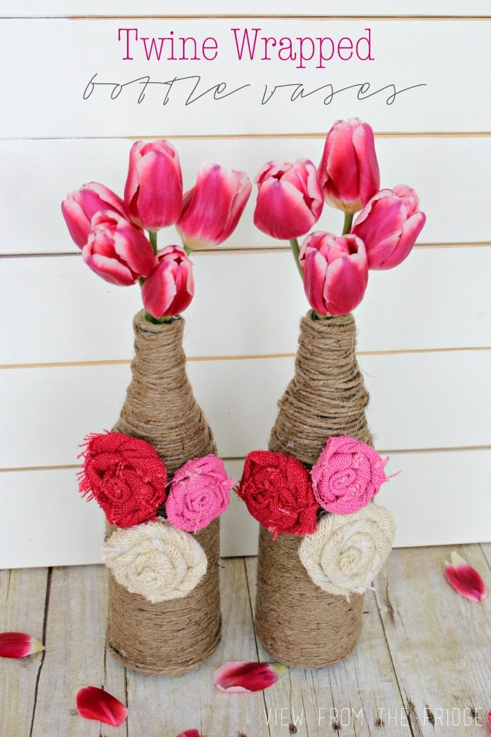 Upcycle your old wine bottles (or San Pelligrino bottles, in my case) into fun and festive bottle vases! Learn how to make these burlap rosettes to add some color, too!